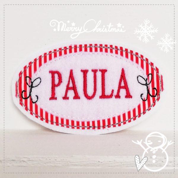 Aufnäher für Weihnachten in rot mit weiß sowie Wunschnamen.