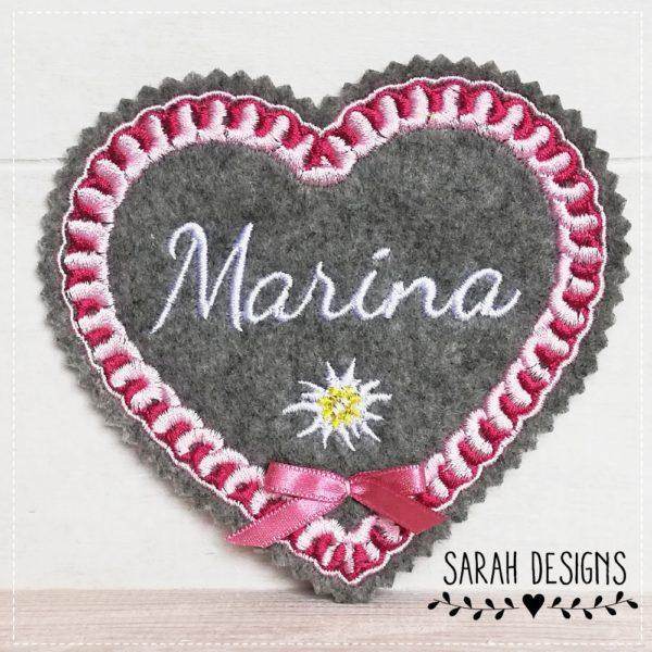 Bügelbild Lebnkuchen Lebkuchenherz mit Wunschnamen mit schöner Zuckerglasur gestickt auf graumelierten Textilfilz 12cm x 11cm